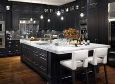 Luxury kitchen for wining and dining any guest.  :)  Oceanside Glasstile backsplash in Extrados.