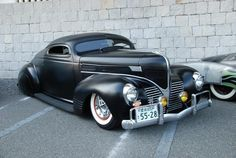 1939 Dodge coupe with a beautiful custom and lowering job. I had a 4dr 39 sedan that I leaded in the trunk  and front of hood, but it never looked like this.