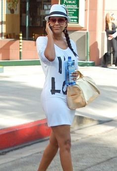 White graphic dress and hat, gold bag:Lisa Raye