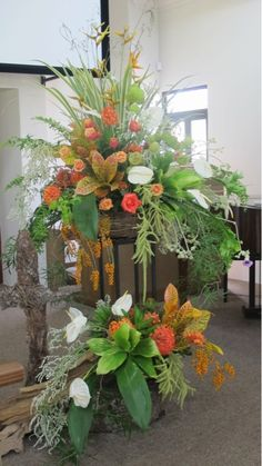Love the colors, smaller scale Alter Flowers, Church Flowers, Funeral Flowers, Large Flowers, Amazing Flowers, Tropical Flower Arrangements, Church Flower Arrangements, Funeral Arrangements, Jeff Leatham