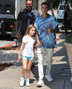 Retail therapy: After a rough couple of days Justin Bieber relaxed by treating younger sister Jazmyn to a shopping trip at The Grove in Los Angeles