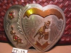 WESTERN-FLAIR-Hand-Made-Double-Heart-Barrel-Racing-Horse-Belt-Buckle-$225 or MAKE-OFFER We are OLDWEST on eBay and have over 1200 vintage belt buckles listed us. Here is the link: http://stores.ebay.com/OWN-A-PIECE-OF-THE-OLDWEST E-Mail us at saddlerestoration@hotmail.com