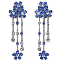 11.32 Carat Rich Blue Floral Sapphire Diamond Earrings | From a unique collection of vintage dangle earrings at https://www.1stdibs.com/jewelry/earrings/dangle-earrings/