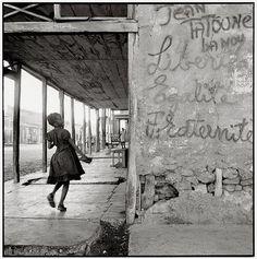 """by Danny Lyon  """"Liberté, égalité, fraternité"""". Gonaives, Haiti, February 9, 1986."""