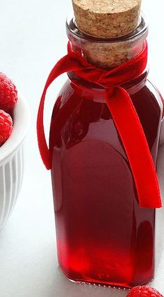 Homemade Raspberry Syrup Easy recipe Luscious thick bright jewellike rubyred in color and bursting with fresh raspberry flavor our Raspberry Syrup is easy to. Raspberry Syrup Recipes, Raspberry Desserts, Strawberry Syrup, Salsa Dulce, Homemade Syrup, 3 Ingredient Recipes, Wicked Good, Kinds Of Desserts, Canning Recipes