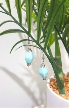 Check out this item in my Etsy shop https://www.etsy.com/au/listing/546916561/vintage-look-light-blue-drop-earrings