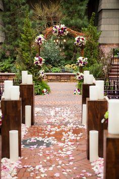 An incredible ceremony setup at Brisa Courtyard at Disney's Grand Californian Resort. Look at that arch! Photo: Jenna, White Rabbit Photo Boutique