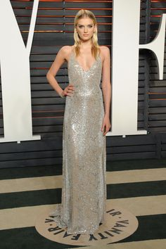 Model Lily Donaldson at the Vanity Fair Oscars after-party wearing Forevermark by Crossworks Ideal Cushion diamond stud earrings and stacked  diamond Forevermark by Natalie K and Forevermark by Rahaminov bracelets.