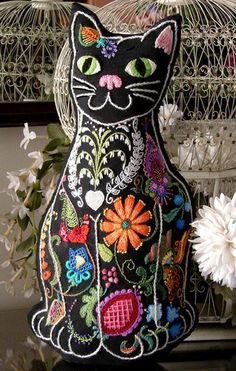 "Barrani Design Studios - Sassy Cat - FIBER CANDY Embroidery. This jaunty kitty struts her stuff in over 25 different crewel stitches, embroidered on the back as well as the front. Worked on 100% black linen with 100% wool persian yarn, it measures 12"" x 20."" Kit includes two stamped linens, color label, full instructions, 100% wool yarn, and needle in a zip poly bag."