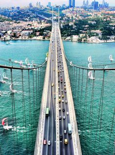 The Bosphorus Bridge, Istanbul, Turkey. The Bosphorus Bridge is one of the two bridges in Istanbul, Turkey, spanning the Bosphorus strait and thus connecting Europe and Asia. It is a gravity anchored suspension bridge with steel pylons and inclined hanger Places Around The World, Travel Around The World, Around The Worlds, Places To Travel, Places To See, Wonderful Places, Beautiful Places, Bosphorus Bridge, Voyage Europe