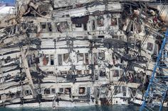 2013: The Year in Pictures - The New York Times The wreckage of the Costa Concordia cruise liner was raised off the coast of the Tuscan island of Giglio.