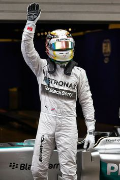 Lewis Hamilton acknowledges the crowd in Shanghai following his dominating win at the 2014 Chinese Grand Prix. It is Hamilton's third straight of the season and his third at the track, as well. Teammate Nico Rosberg (not pictured) rallied after a touch-and-go with Williams' Valtteri Bottas at the start to finish P2. It is Mercedes' third 1-2 finish of the year.