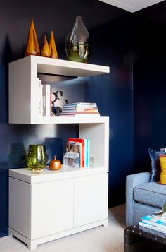 White bookshelves in navy room