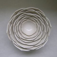 Eight Nesting Lotus Ceramic Bowls in Milk White