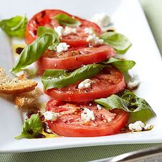 Caprese Salad with Ciabatta Chips Simple and beautiful, this knife-and-fork salad celebrates juicy summer tomatoes and features chips made with Parmesan-topped slivers of toasted Panera Bread Ciabatta. Asian Chicken Salads, Chicken Salad Recipes, Tomato Basil Salad, Cooking Recipes, Healthy Recipes, Bread Recipes, Goat Cheese Salad, Comida Latina, Mediterranean Dishes