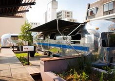 """Grand Daddy Hotel; Cape Town, South Africa - This boutique hotel enlisted local artists and interior designers to gut-renovate a fleet of Airstream trailers on its roof. """"Dorothy"""" is robin's-egg blue with white polka dots and hosts a miniature exhibition that the artist updates every three months (trailers from $157 per night; granddaddy.co.za)."""