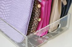 Use an acrylic tray to organize clutches.