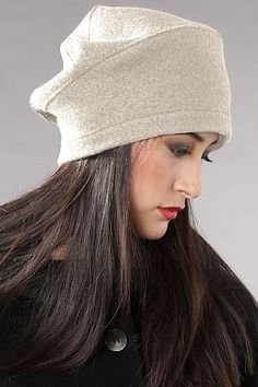 Cap Aurika Feminine, elegant and perfect for the urban look: this unique OSKA cap will round off your look and be a pleasure to wear. Decorative stitching emphasizes the seams. High-quality OSKA boiled wool, new Mouliné colours, exclusive to OSKA 100% Virgin Wool Do not wash, Do not bleach, Do not tumble dry, Low iron, Dry clean €59.00