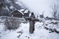 A Kinnaura tribeswoman carrying wood back to her home in the highlands of northern India.