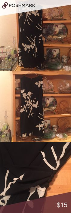 Black and white dress Beautiful lined, back zip, sleeveless dress. This is so pretty on. Gathers at waist with covered buttons. The pictures do it no justice. It has a tailored fit and falls just above the knee. Warren Dresses