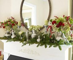 Grace the mantel with classic collectibles, such as pewter pitchers and vases. Surrounded by evergreen boughs and filled with festive blooms, the everyday items join the celebration./