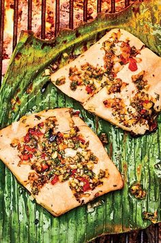 Many cooks only grill thick fish steaks because thin fillets break and fall into the fire. But a banana leaf solves the problem elegantly. It's naturally nonstick, covers the rack, and lends subtle grassy sweetness to thinner fillets like flounder, snapper, tilapia, and sole, along with smoky grilled flavor.#salmon #seafood #salmonrecipes #salmondishes Salmon Dishes, Seafood Dishes, Into The Fire, Tilapia, Cooking Light, Steaks, Salmon Recipes, Vegetable Pizza, Grilling