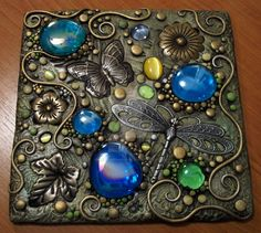 I've decorated this blank journal with polymer clay, pearls, iridescent glass gems, crystal droplets, metal starfish and seahorse, acrylic paint and PearlEx powdered pigments. The border was hand-p...