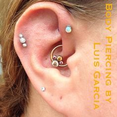 Fresh daith piercing with an @anatometalinc copper titanium captive and a gemcluster featuring champagne, amber, and pink CZs #piercing #bodypiercing #philly #philadelphia #southstreet #AssociationofProfessionalPiercers #appmember #safepiercing #NoKaOiBodyPiercing #instagood #instacool #jewelry #bodyjewelry #picoftheday #mybodymod #bodymodlife #legitpiercingslook #legitbodyjewelry #gemcluster #daith #anatometal  (at No Ka Oi Tiki Tattoo)