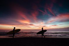 Surfers on the beach at sunset in Costa Rica. Photographed by Kristen M. Brown, Samba to the Sea at The Sunset Shop.