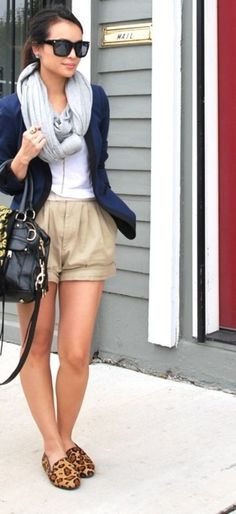 way too cool. love the knotted scarf/navy blazer/cuffed and relaxed shorts. leopard shoes. everything.