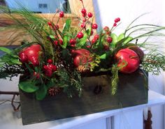 christmas decorations with apples | apple holiday planter a wooden planter is filled with apples