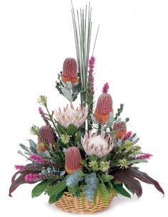 Native floral basket: Had these types of flowers for our Pop's funeral