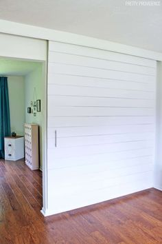 With UFP-Edge™ rustic shiplap and trim boards which feature the natural textur.With UFP-Edge™ rustic shiplap and trim boards which feature the natural texture of rustic wood, you can easily build an interior barn door with Sliding Door Room Dividers, Sliding Screen Doors, Room Divider Doors, Sliding Wall, Diy Room Divider, Diy Barn Door, Sliding Barn Door Hardware, Divider Ideas, Barn Door White