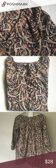"J Crew Paisley Tunic Navy and cream paisley with red, orange, olive accent colors. Wide, round neck. 3/4 length sleeves with button detail at end. Split hem. 100% Cotton. Very thin material, and sheer. Six buttons on front at top. Tunic length, could also be a bathing suit cover. About 28"" long from top of shoulder to hem. Approx 19"" from underarm to underarm. All measurements when laid flat. Never been worn, but has sat in closet for over a year, so not exactly new. Great condition! J. Crew…"