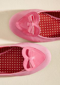 Make your signature sweet style utterly unmistakable by sporting these pink flats! Covered in sumptuous faux suede and adorned at the toes with glossy, bow-topped hearts, this pair from B.A.I.T. Footwear allows you to toot your own style's horn.