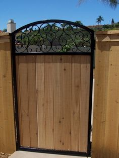 Decorative iron walk gate with wood inlaid - Yelp
