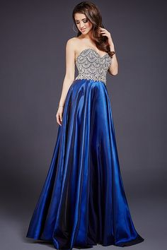 Gorgeous strapless floor length satin skirt and fully beaded top with sweetheart neck.