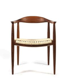 HANS J. WEGNER, The Chair, 1950. Manufactured by Johannes Hansen, Denmark. Walnut and cane. / 1stDibs