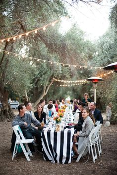 Stripes and twinkle lights al fresco Photography: Candice Benjamin Photography