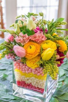 hoppy easter We are all looking for fun ideas to create some festive touches around the house for Easter. Creating a Jelly Bean Easter Arrangement is so easy and fun! Easter Flower Arrangements, Easter Flowers, Spring Flowers, Floral Arrangements, Centerpiece Flowers, Cut Flowers, Easter Centerpiece, Spring Bouquet, Beautiful Flower Arrangements