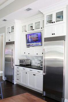 Tv in Kitchen between full size refrigerator and full size freezer #kitchendesign #blackandwhitekitchen