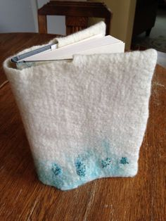 Wet felted book cover with decorative beading