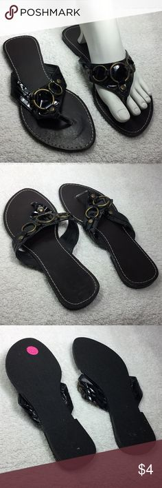 """Merona Thong Sandals Black 7M Flats This is a cute pair of Merona flat thong sandals size 7 medium in nice condition. They have patent leather looking straps with gold ring decor. Measure: 9.5 """" long, 3.5"""" wide and have a less than 1/2"""" heel. Smoke free seller. Please use PayPal. Thanks for looking in my closet! Merona Shoes Sandals"""