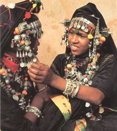 Africa | 'The Tissint from southern Morocco are part of an ancient group of mixed races of part-negroid descent known as the Haratine.  With the preference for bold, colourful and flamboyant designs, these women collect quantities of valuable jewellery - as fast as their husbands' wealth allows | Text and image © Angela Fisher; publication Africa Adorned.