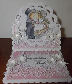 Easel card created with Penny Black stamp 'With this ring', coloured with copics, diecuts by Marianne Design