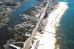 Four Seasons condo's pier and island view - aerial.  Click the link to visit our website and view current Orange Beach, AL homes for sale.  http://www.condoinvestment.com/orange-beach-al-subdivisions.php