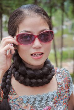 Xia Aifeng with scarf of braid