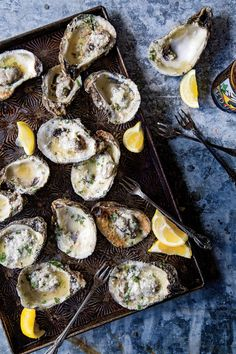 Grilled Oysters with Lemon-Garlic Butter - September 2016 Recipes - Southernliving. Recipe:Grilled Oysters with Lemon-Garlic Butter