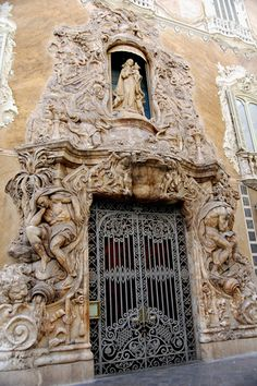 Valencia, Spain - Ornate doorway in historical city, North of where I lived in a 15th c. fishing village (Javea-P. de Alicante) with its own churches that withstood wars and prayers from faithful over centuries.