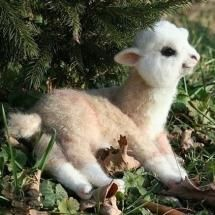 ALPACA BABY I believe this is a real baby alpaca although it looks mighty like a stuffed animal! I was wrong...It is not real.  It is a stuffed animal